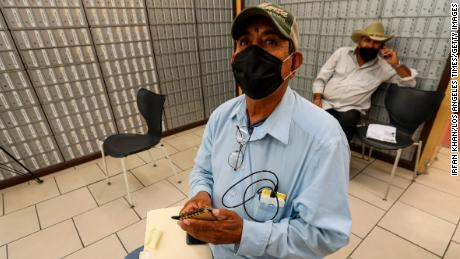 Fernando Fausto, 59, a resident Mexicali, appears at a private service agency to file for unemployment on July 1, 2020 in Calexico, Calif.