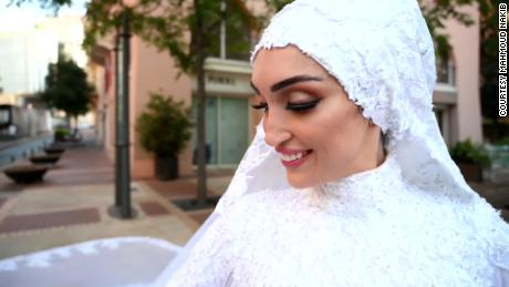 One moment, they were filming the bride in her wedding dress. Then came the explosion