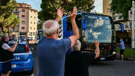 Atalanta's fans cheer as the bus transporting Atalanta players arrives at the stadium for the match against Sassuolo.