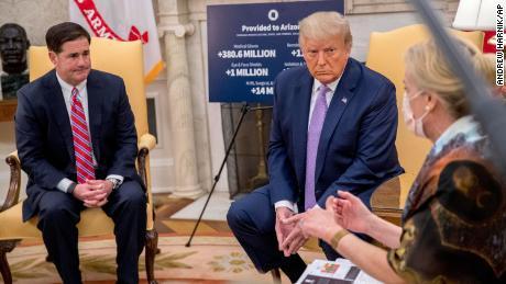 Dr. Deborah Birx, White House coronavirus response coordinator, right, speaks as President Donald Trump, center, meets with Arizona Gov. Doug Ducey, left, in the Oval Office of the White House in Washington, Wednesday, August 5, 2020.