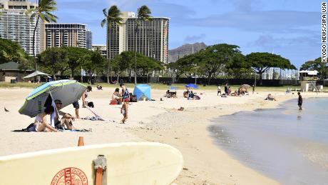 Hawaii reinstates inter-island travel quarantine and other restrictions as Covid-19 cases surge