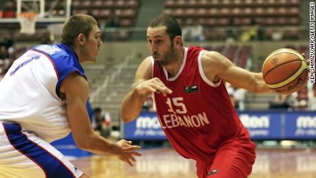 Lebanon's Fadi El Khatib (R) drives past Serbia and Montenegro's Miroslav Raicevic (L) during their Group A preliminary round match on the third day of the World Basketball Championship in Sendai, in Miyagi Prefecture, 21 August 2006. Serbia and Montenegro won 104-57.