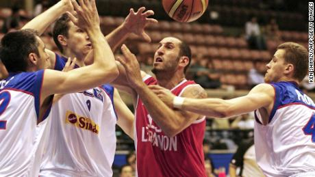 Lebanon's Fadi El Khatib (C) is blocked by Serbia and Montenegro's Goran Nikolic (L), Mile Ilic (2nd L) and Bojan Popovic (far R) as he goes to the basket during their Group A preliminary round match on the third day of the World Basketball Championship in Sendai, in Miyagi Prefecture, 21 August 2006.
