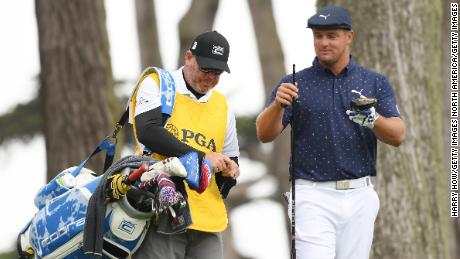 DeChambeau fixes his new shaft to his driver.