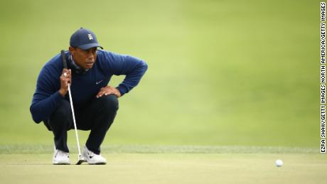 Woods lines up a putt on the 13th green.