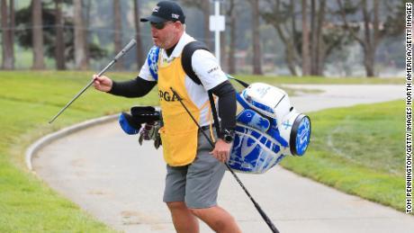 DeChambeau's caddie Tim Tucker carries the US golfer's new driver shaft.