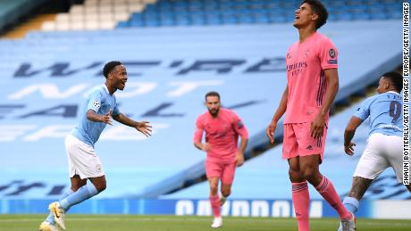 Raheem Sterling celebrates after scoring Manchester City's first goal.