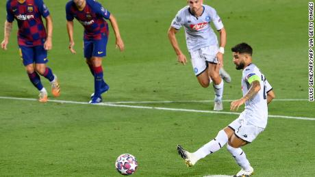 Napoli's Lorenzo Insigne scores from the spot to pull a goal back for his side against Barcelona in the Camp Nou.