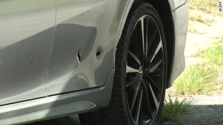 The officers fired multiple shots at the car, the GBI said.