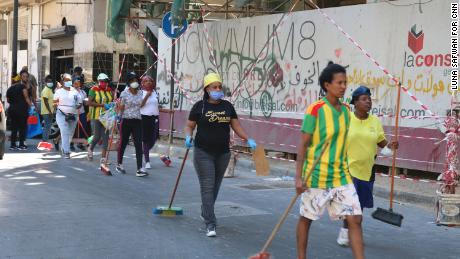Ethiopian men and women head to Beirut's downtown to help clear up the city's streets.