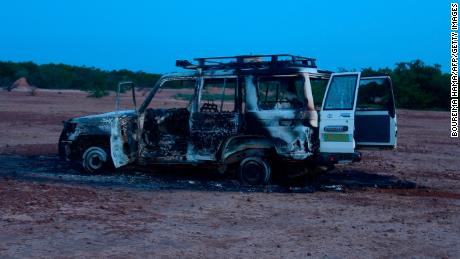 This August 9, 2020 image shows the wreckage of the car where six French aid workers, their local guide and the driver were killed by unidentified gunmen riding motorcycles in an area of southwestern Niger. - Gunmen on motorcycles killed eight people including a group of French aid workers as they visited a part of Niger popular with tourists for its wildlife.