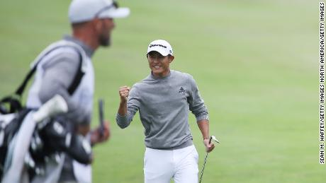 Morikawa celebrates chipping in for birdie on the 14th hole.