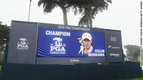 Morikawa is congratulated on a leaderboard after winning the 2020 PGA Championship.