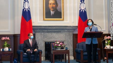 US Secretary of Health and Human Services Alex Azar (L) looks on as Taiwan's President Tsai Ing-wen (R) speaks during his visit to the Presidential Office in Taipei on August 10.