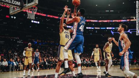 Philadelphia 76ers player Glenn Robinson III takes a shot against the Los Angeles Lakers