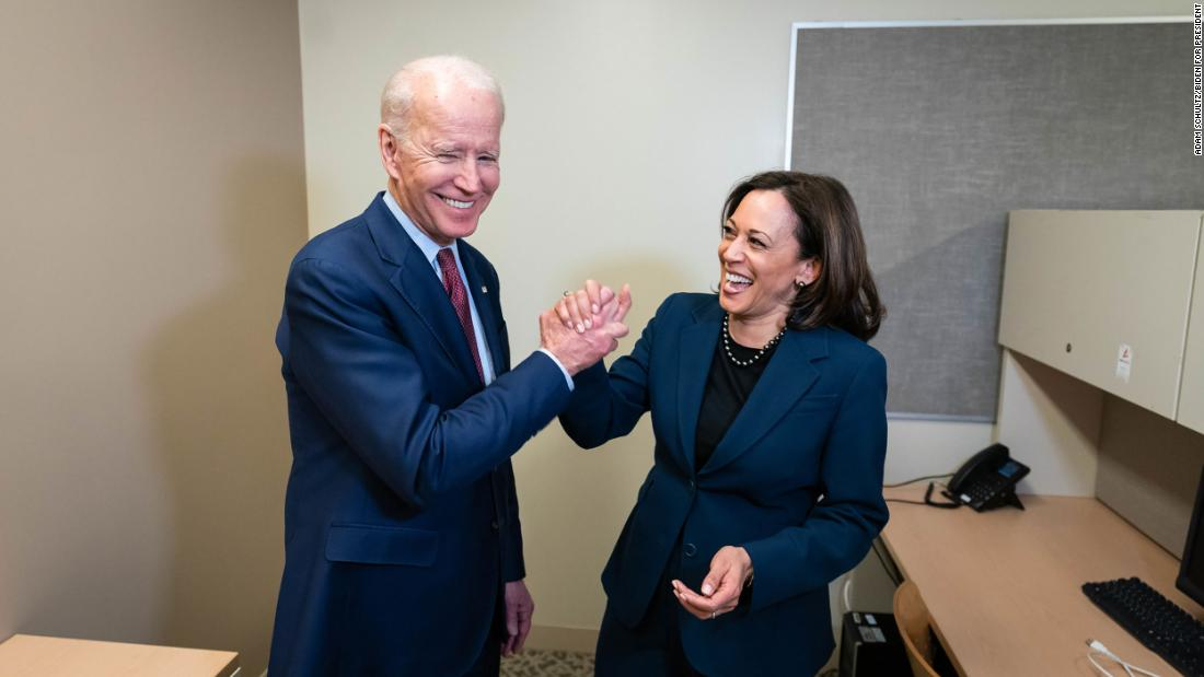"Biden and US Sen. Kamala Harris greet each other at a Detroit high school as they attend a ""Get Out the Vote"" event in March 2020. Harris had dropped out of the presidential race a few months earlier."