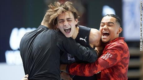Duplantis (center) celebrates after setting the world record in Torun, Poland, this February.