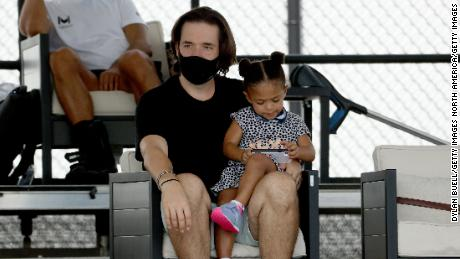 Alexis Ohanian and Olympia look on during Tuesday's match.