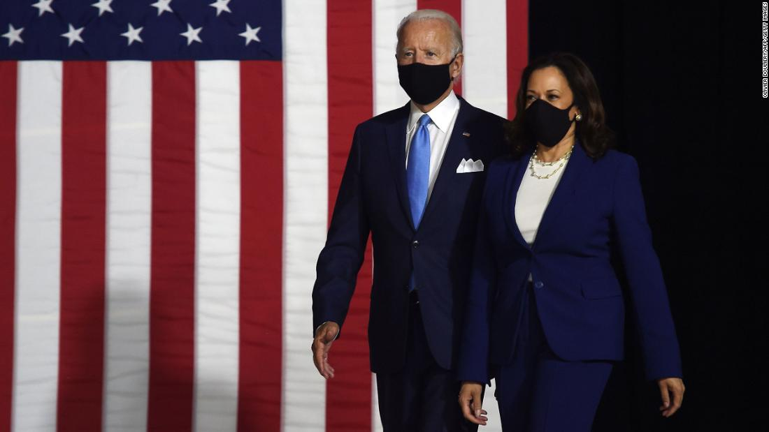 "Biden and Harris walk out for <a href=""http://www.cnn.com/2020/08/12/politics/gallery/joe-biden-kamala-harris-first-appearance/index.html"" target=""_blank"">their first campaign event</a> as a presidential ticket."
