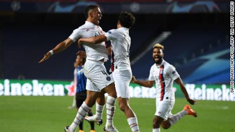Paris Saint-Germain score two late goals to book its place in the semifinals.