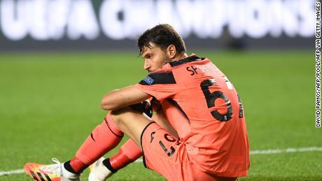 Atalanta goalkeeper Marco Sportiello slumps to the ground after the game.