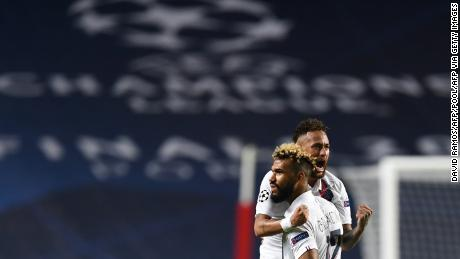 Eric Maxim Choupo-Moting (right) and Neymar react during PSG's Champions League quarterfinal victory.