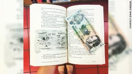 "This banknote from Honduras was found in Sherman Alexie's ""The Absolutely True Story of a Part-Time Indian."" Smreker said she has found currency and receipts from around the world that previous readers used as makeshift bookmarks."