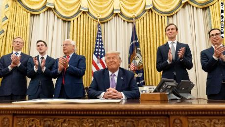 President Donald Trump, accompanied by from left, US special envoy for Iran Brian Hook, Assistant to the President Avraham Berkowitz, US Ambassador to Israel David Friedman, White House senior adviser Jared Kushner, and Treasury Secretary Steven Mnuchin, in the Oval Office on August 12.