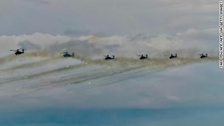 US-made AH-64E Apache attack helicopters take part in the annual Han Kuang military drills in Taichung on July 16.