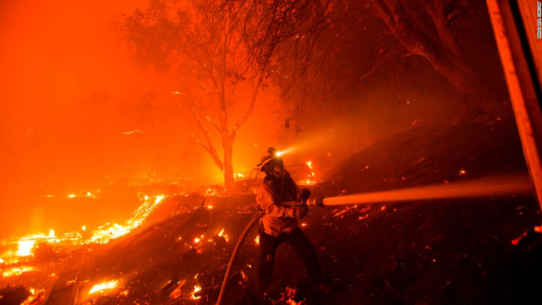 A firefighter works against the Lake Fire on August 12.