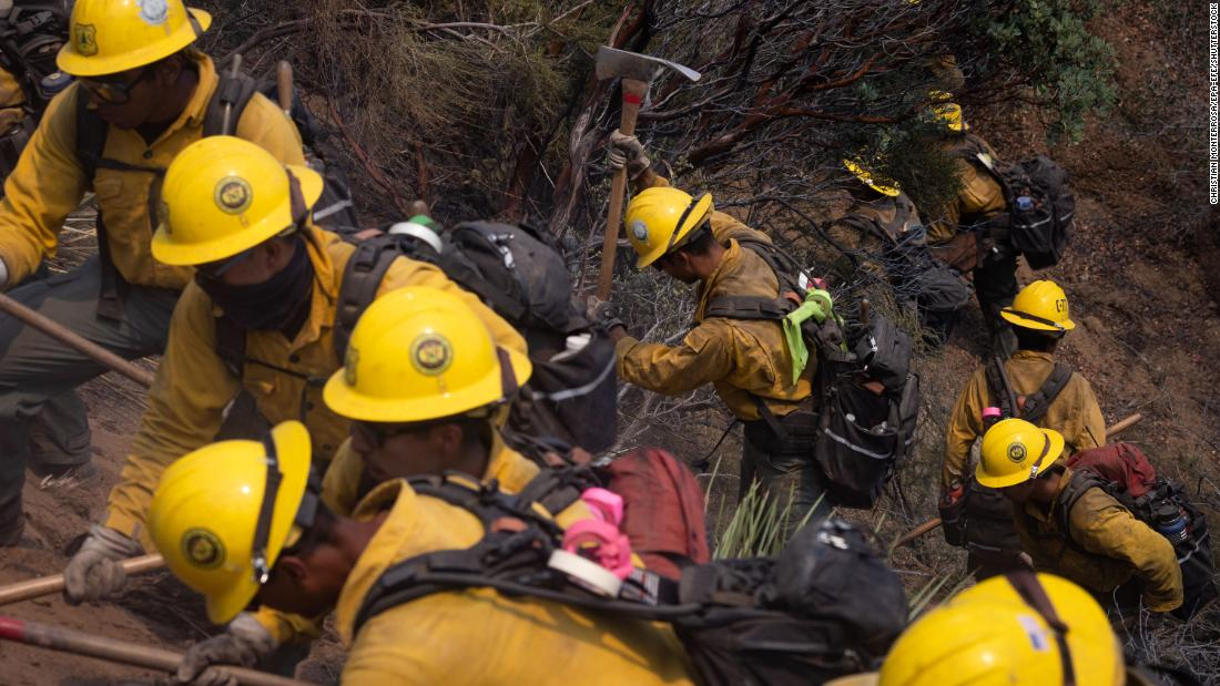 A firefighter crew works in Lake Hughes on August 13.