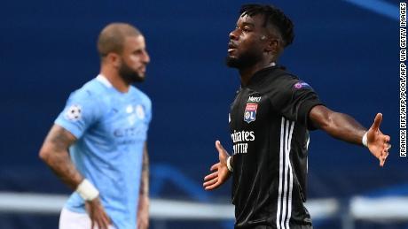 Forward Maxwel Cornet celebrates scoring Lyon's first goal against Manchester City on Saturday, August 15.