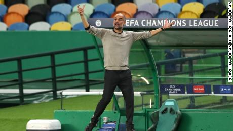 Manchester City manager Pep Guardiola reacts during the game against Lyon.