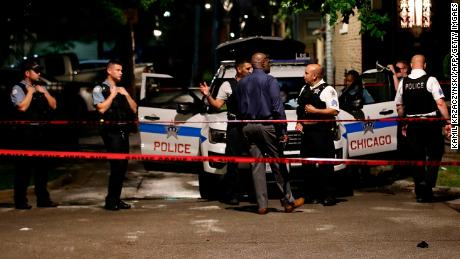 Police officers investigate the scene of a shooting in Chicago, Illinois, on July 21, 2020.