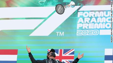 Hamilton celebrates on the podium after winning the Spanish  Grand Prix.