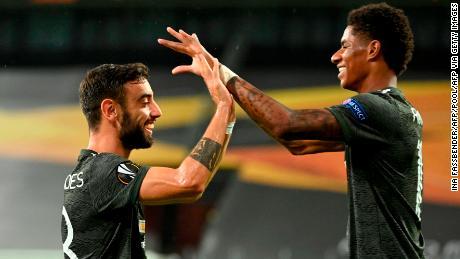 Bruno Fernandes celebrates scoring the opening goal with his teammate Marcus Rashford.