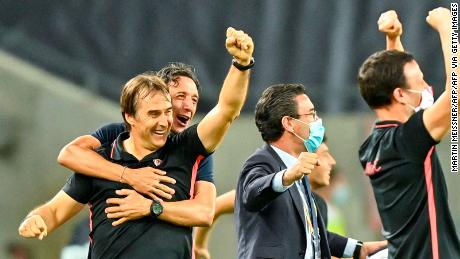 Sevilla's coach Julen Lopetegui (left) and staff celebrate on the final whistle after victory against Manchester United.