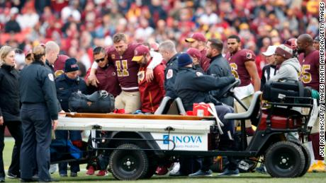 Alex Smith is helped off the field after his injry in November 2018.