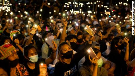 Students and anti-government protesters light up their phones at Democracy Monument on August 16, 2020 in Bangkok.
