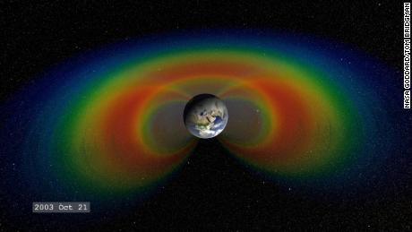 When solar material streams strikes Earth's magnetosphere, it can become trapped and held in two donut-shaped belts around the planet called the Van Allen Belts. The belts restrain the particles to travel along Earth's magnetic field lines, continually bouncing back and forth from pole to pole.