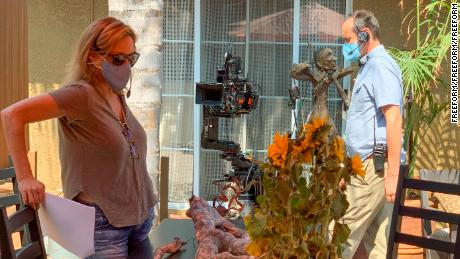 Executive producer Joanna Johnson and cinematographer Marco Fargnoli prep a scene for 'Love in the Time of Corona.' (Freeform)