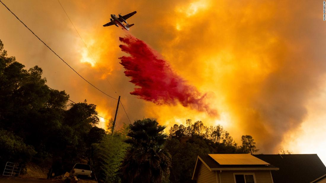 An air tanker drops retardant on fires in the Spanish Flat community of Napa County on August 18.