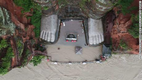 Waters also threatened the Buddha's toes in this photo from August 12.