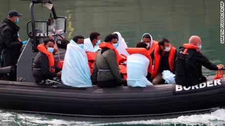 Migrant Channel crossing incidents. A group of people thought to be migrants are brought into Dover, Kent, by Border Force officers following a number of small boat incidents in the Channel earlier today. Picture date: Saturday August 15, 2020. See PA story POLITICS Migrants. Photo credit should read: Gareth Fuller/PA Wire URN:55008753 (Press Association via AP Images)