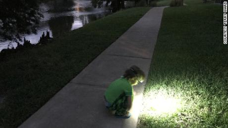 Nico studies the grass while taking in the surrounding sounds in the darkness.