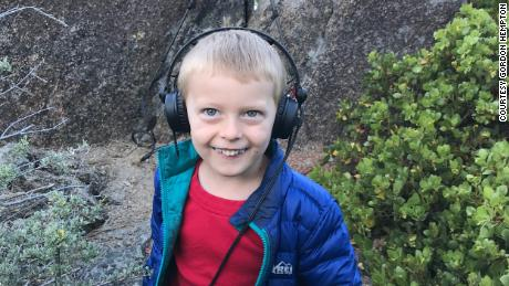Gordon Hempton's grandson, Obi, tunes in to the sounds of nature around Lake Tahoe.
