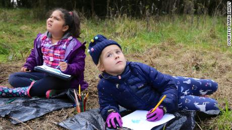 (From left) Roxinny Parra Salgado and Tilly Harris-Taylor observe, listen to and document the sights and sounds of the wetland environment of the Tualatin River outside of Cornelius, Oregon, as part of the curriculum at the Early Learning Community School at Pacific University.