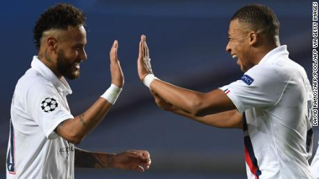 Neymar and Kylian Mbappe celebrate after beating Atalanta.