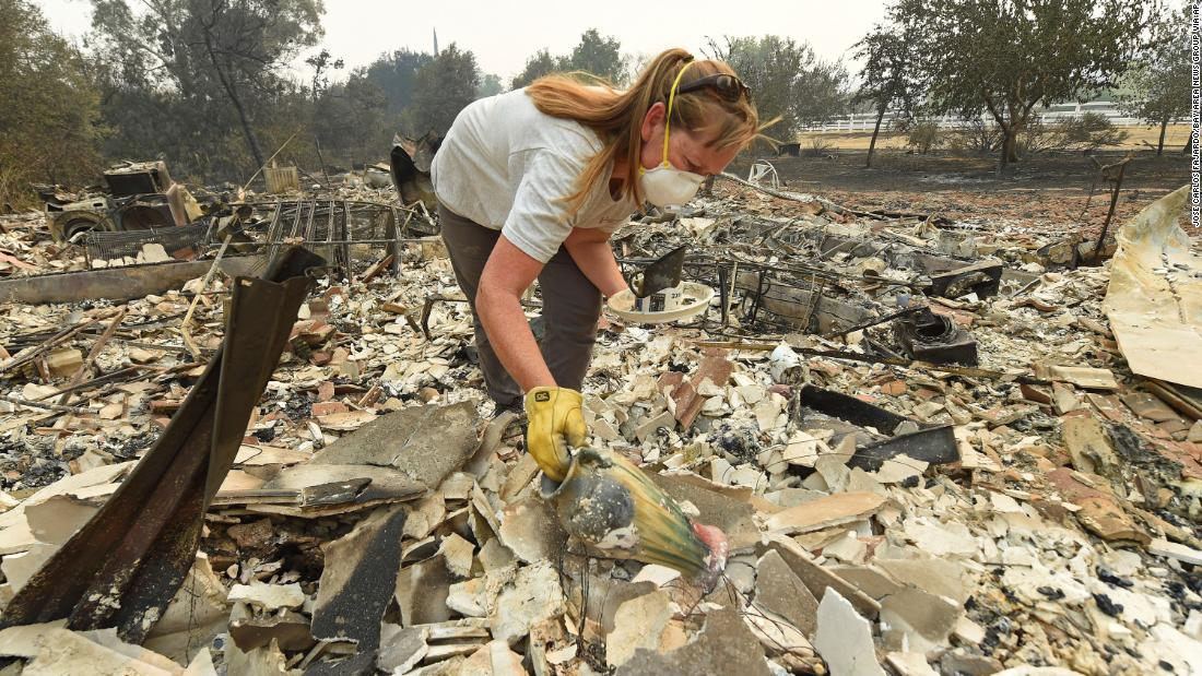 Sarah Hawkins searches through rubble after her Vacaville home was destroyed on August 20.