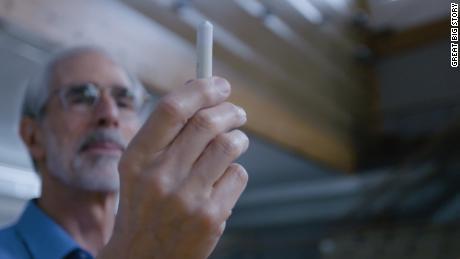 David Eisenbud holds up a stick of Hagoromo, the chalk brand favored among math professors.